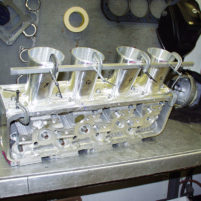 Fabricating billet intake manifold from CNC machined components