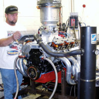 Johnny sets the valves on dyno engine