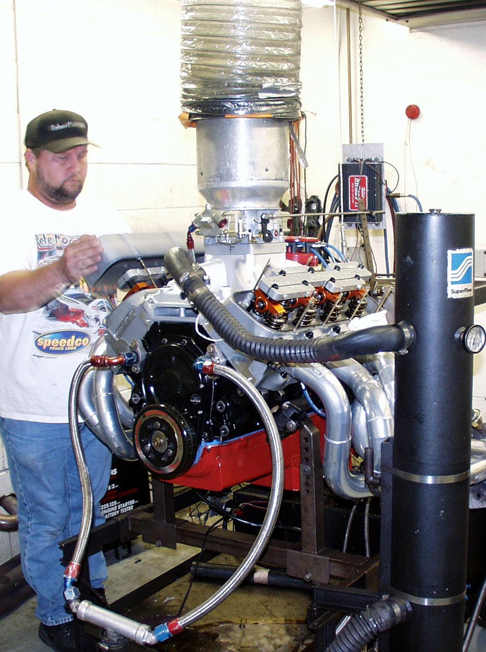 Johnny sets the valves on dyno engine