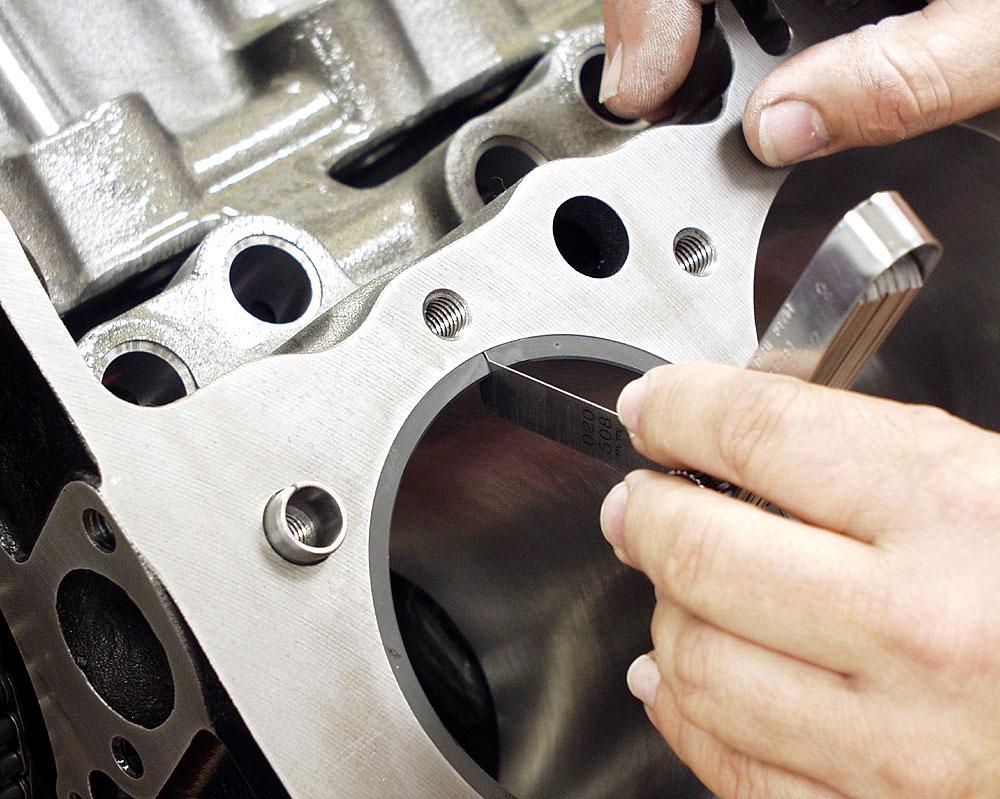 Setting piston ring end gap
